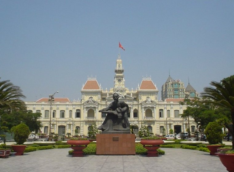 The building of People's Committee and a statue of Ho Chi Minh in Ho Chi MInh City, Vietnam
