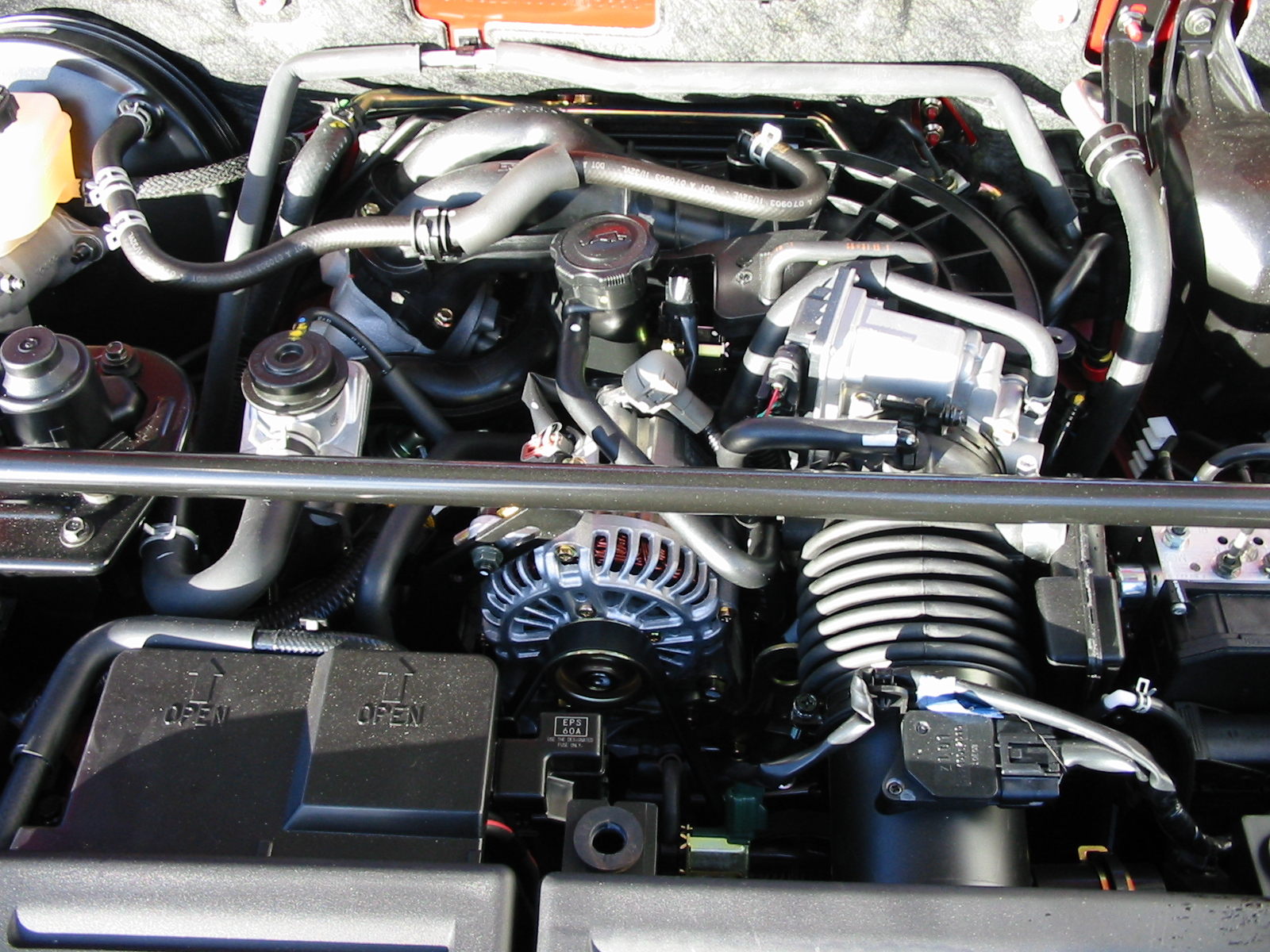 File:Mazda rx-8 engine bay with cover removed.jpg