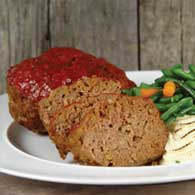 A meatloaf with a tomato sauce topping.