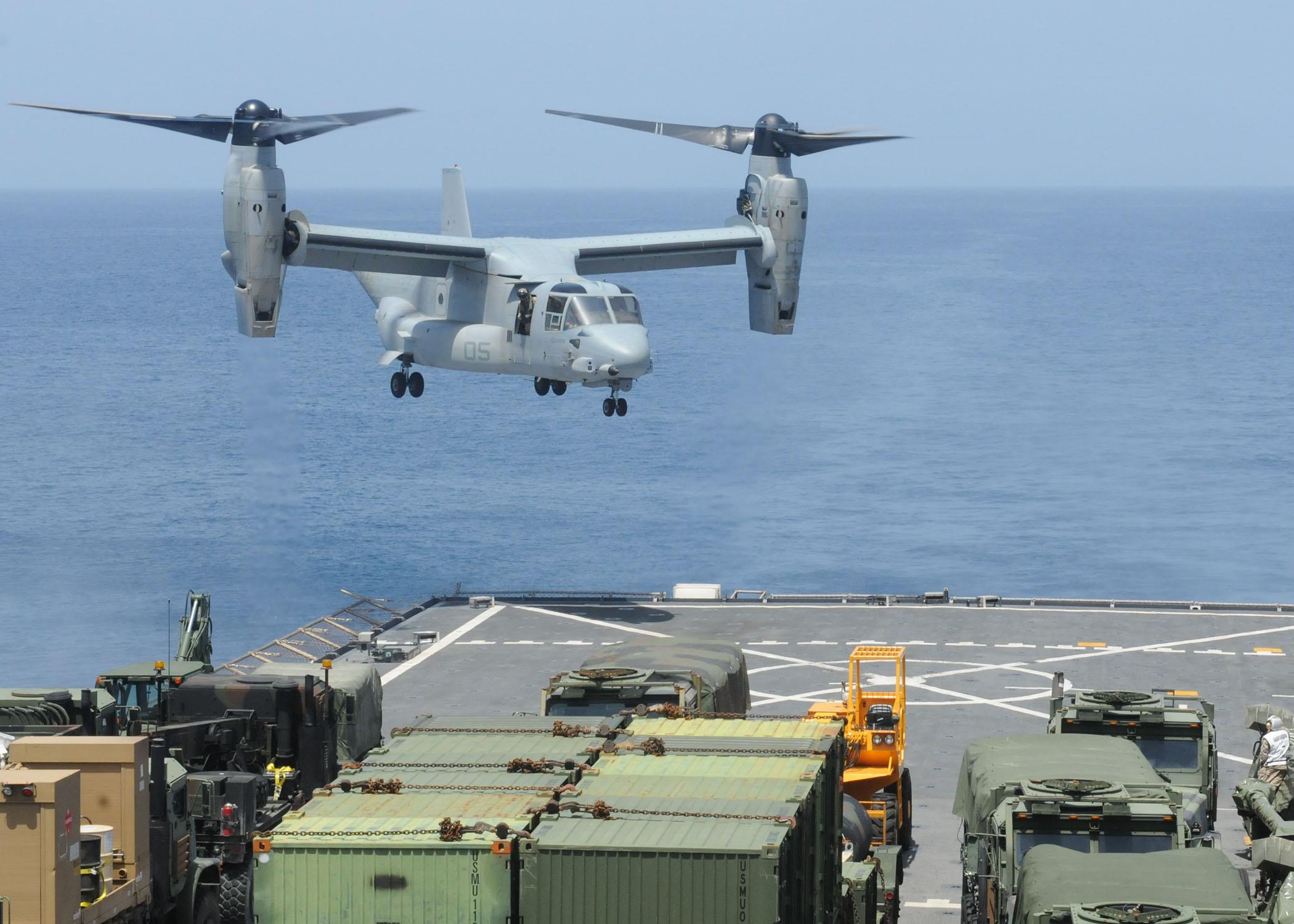 US_Navy_100716-N-8069G-231_A_Marine_Corps_V-22_Osprey_prepares_to_land_on_the_flight_deck_of_USS_Carter_Hall_(LSD_50).jpg
