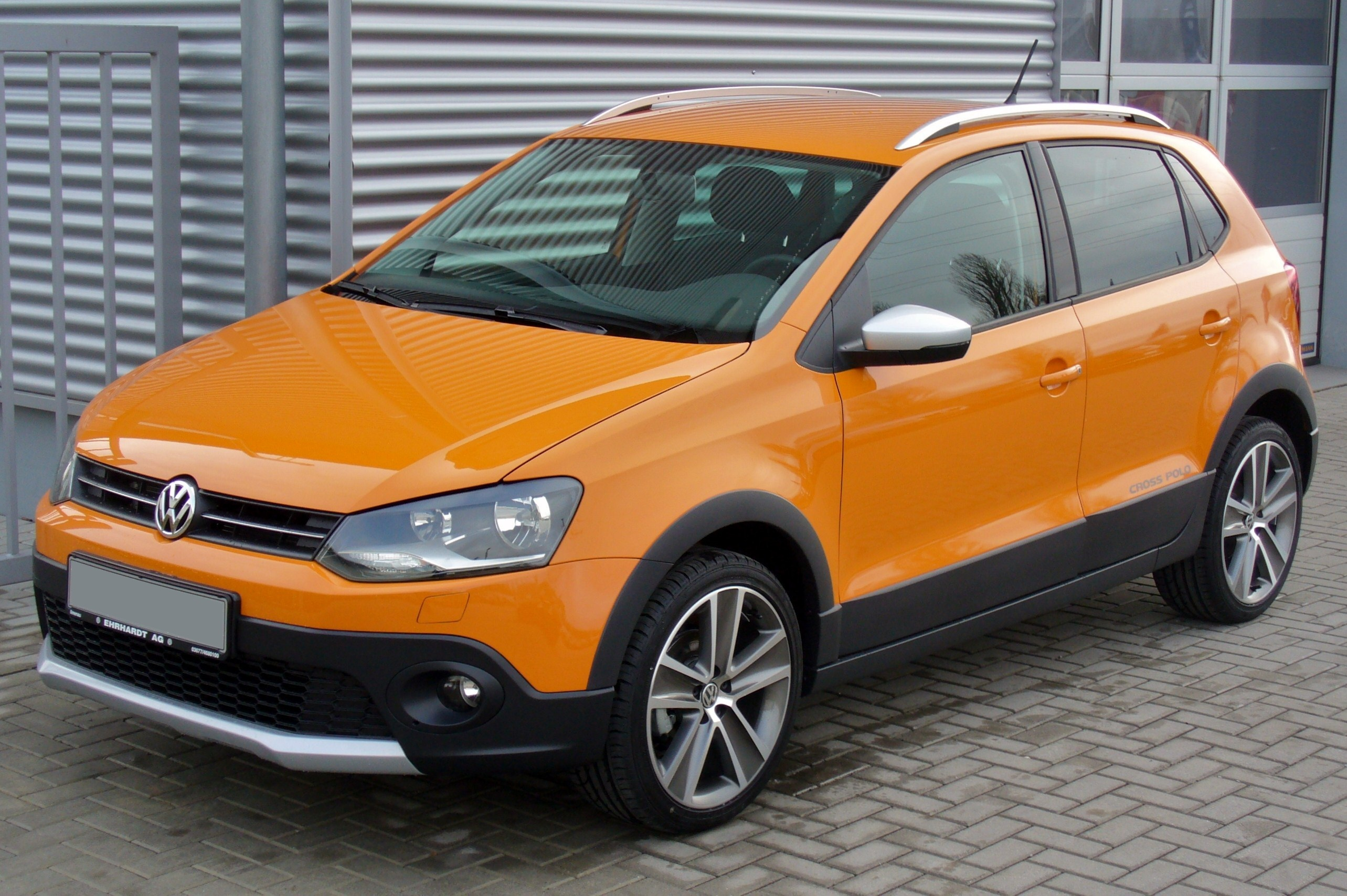 file vw crosspolo 1 2 tsi magmaorange jpg wikimedia commons. Black Bedroom Furniture Sets. Home Design Ideas