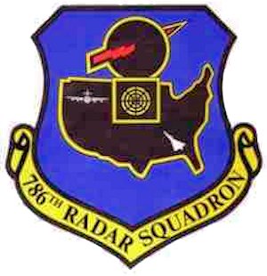 Emblem of the 786th Radar Squadron  On a medium blue shield edged black, a black silhouetted map of the United States, bordered white, surmounted in the chief area of the shield by a black silhouetted radome edged white; an arrow piercing the radome, a radar scope on lower part of radome and two silhouetted aircraft in northwest and southeast corners respectively of the map, all white, details black. The emblem is symbolic of the Aircraft Control and Warning Mission in that electronic detection is indicated by the lightning bolt through the radome; surveillance and control is represented by the radar scope and aircraft and the map of the United States represents the Squadron's constant vigilance in safe-guarding our nation.  emblem approved for use: 16 November 1956.