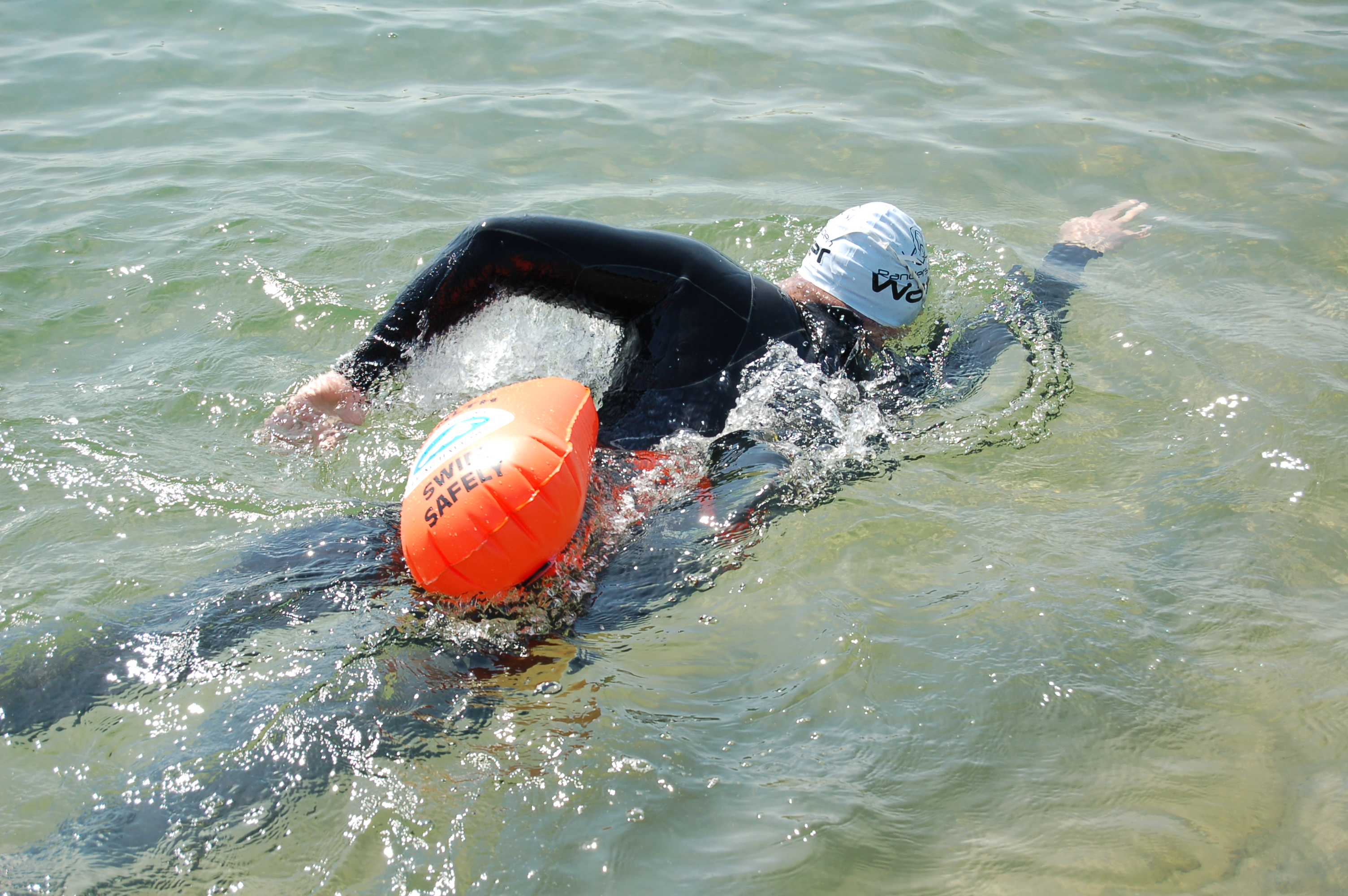 Swimmer with tow float