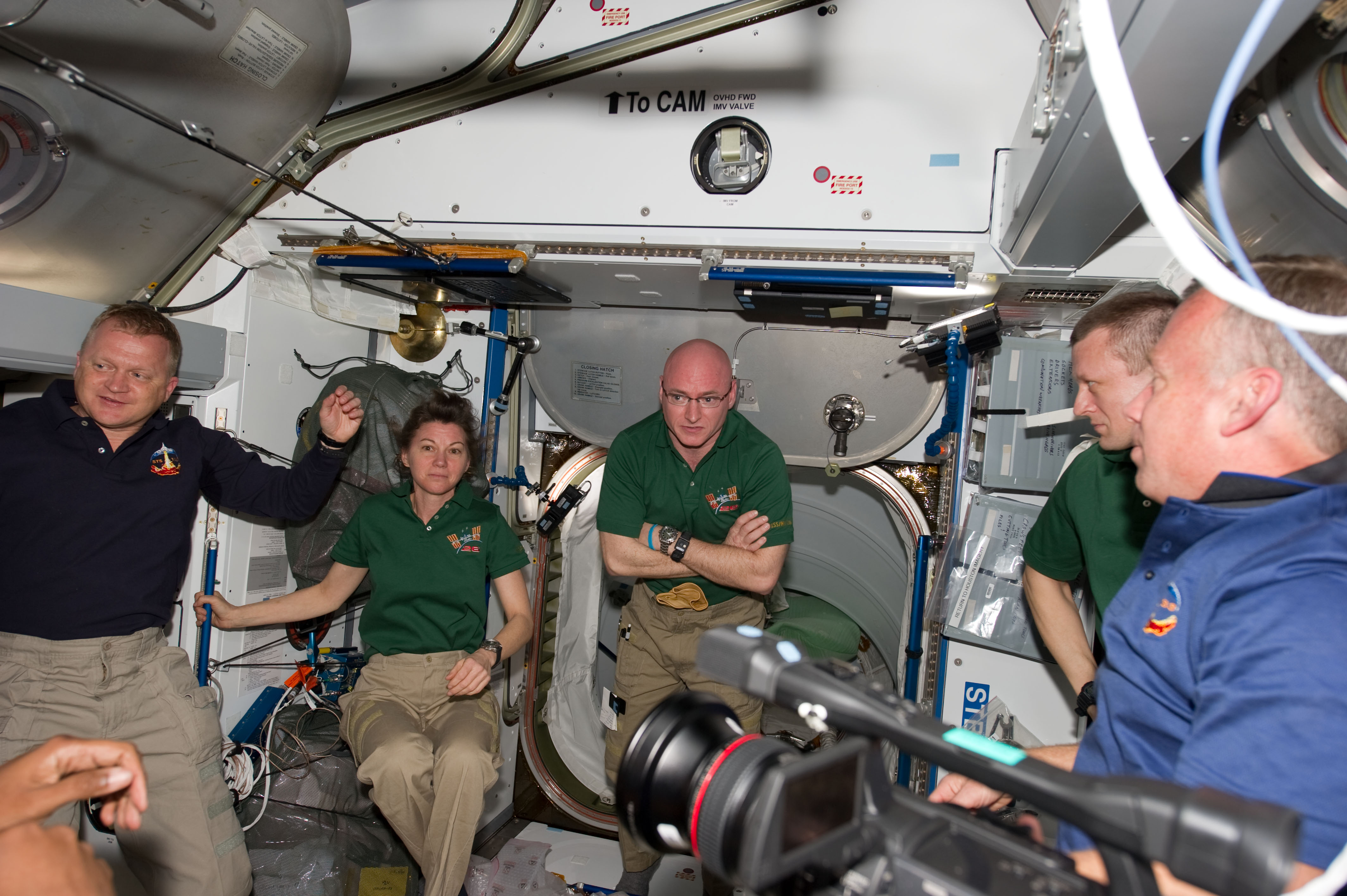 STS-133_ISS-26_crew_members_shortly_after_the_hatches_were_opened.jpg