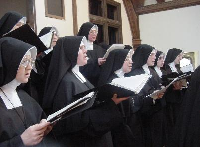 Nuns in traditional habit. Sisters (Daughters of Mary) Roman Catholic Singing.jpg