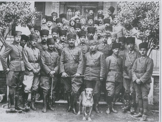 Large group photo, with a dog in front