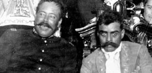 Pancho Villa (left), Commander of the División del Norte (Division of the North), and Emiliano Zapata, Commander of the Ejército Libertador del Sur, joined forces in the Army of the Convention, which fought the Constitutionalist Army of Venustiano Carranza. In practice over the long term, Villa and Zapata fought in different areas, and the Constitutionalists under Alvaro Obregón defeated Villa in 1915. Zapataandvilla.png