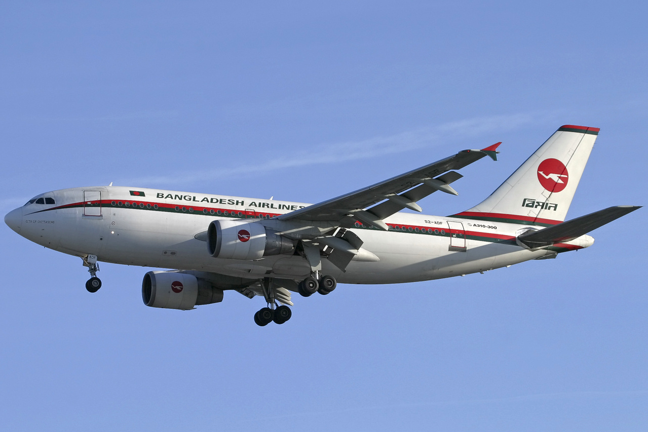 A Biman Bangladesh Airlines Airbus A310-300 in old livery approaches London  Heathrow Airport in 2005.
