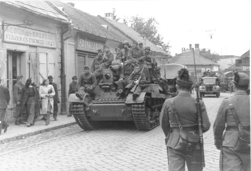 Hungarian soldiers ride a Turan tank