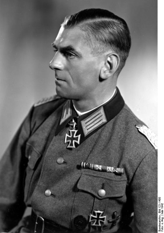 alt=Black-and-white portrait of a man in semi profile wearing a military uniform with an Iron Cross displayed at his neck.