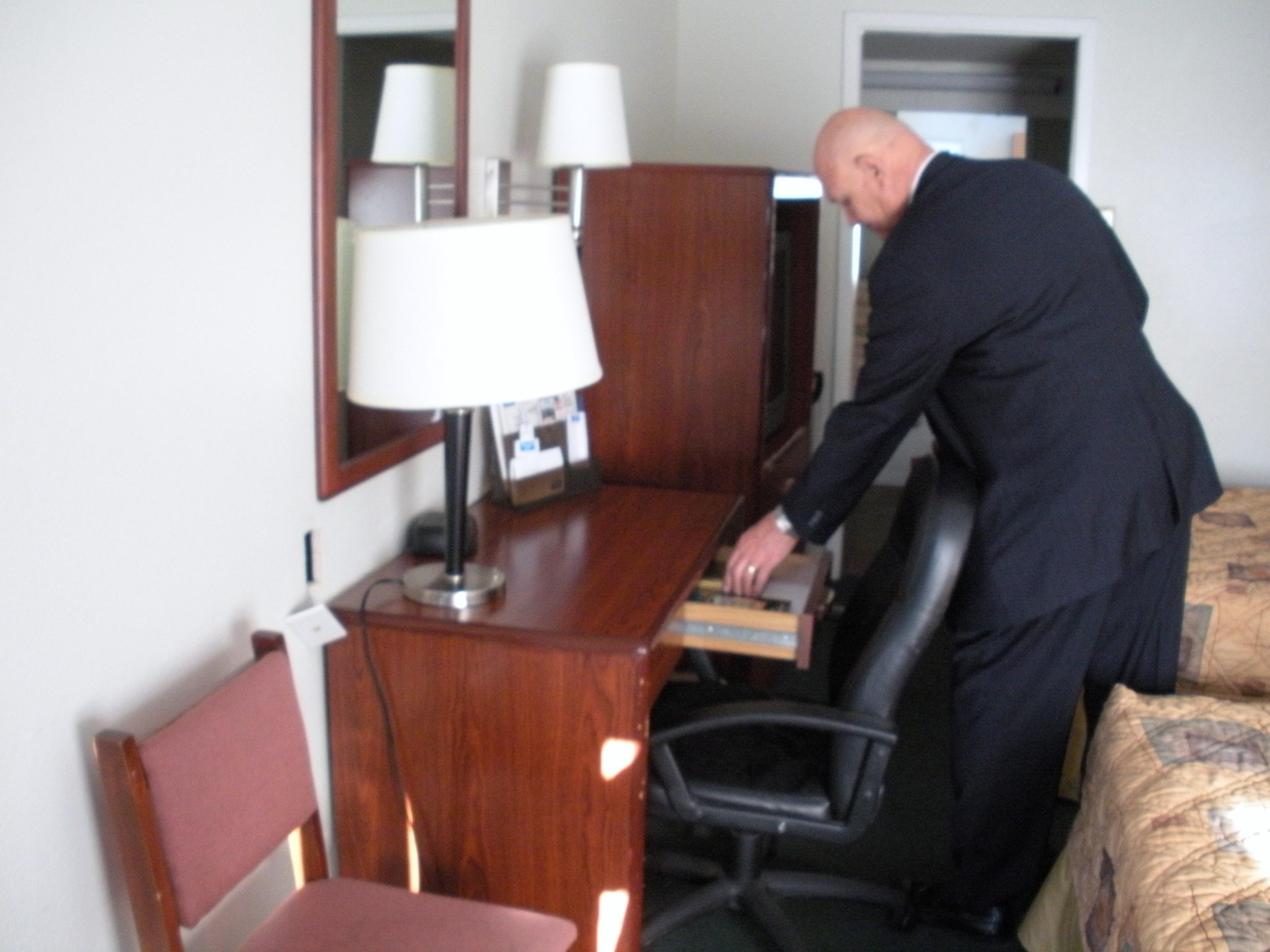 Gideon member distributing scripture in motel room.jpg