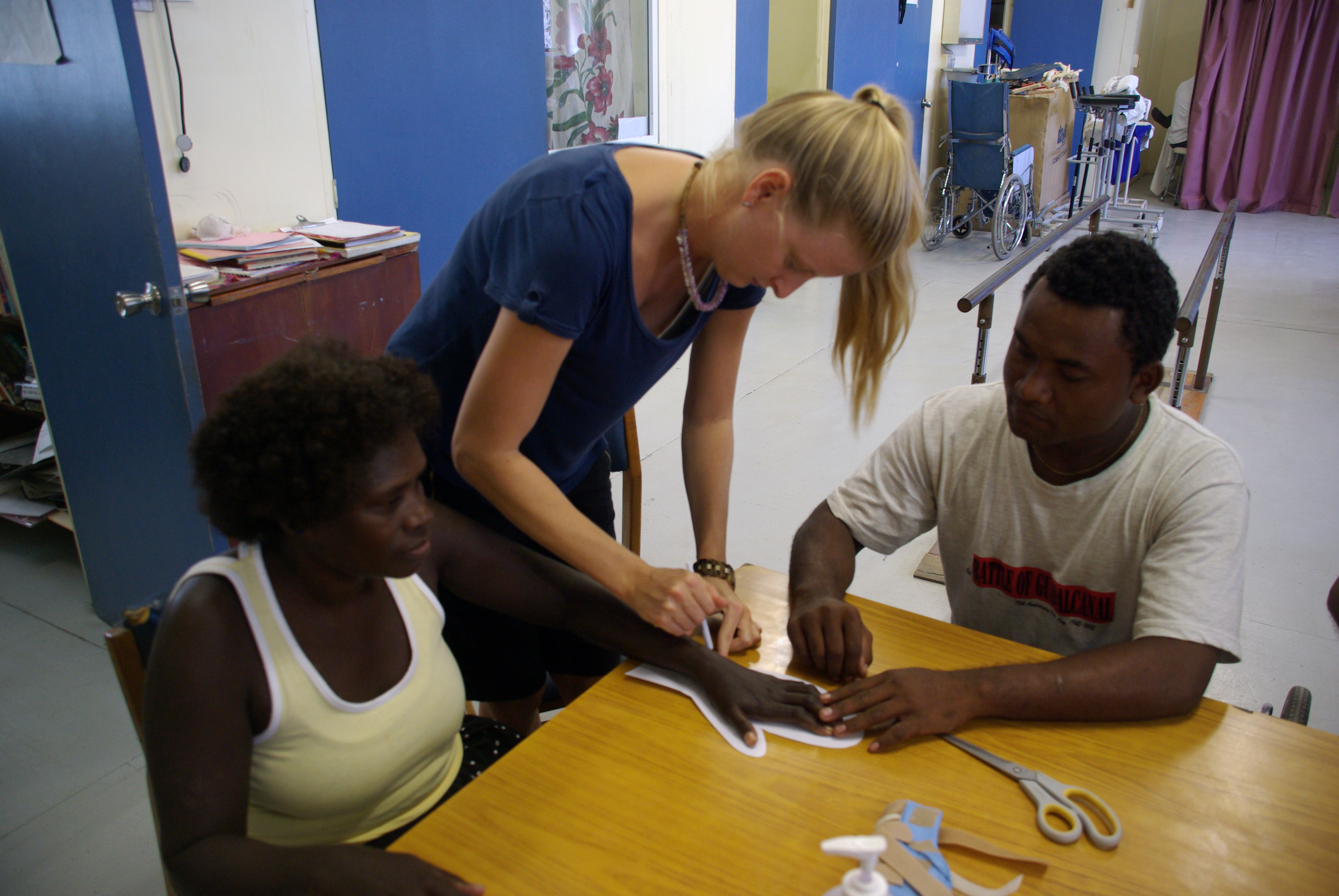 File:Occupational Therapist Melanie Glapa works with student George Hage to assist hand therapy patient