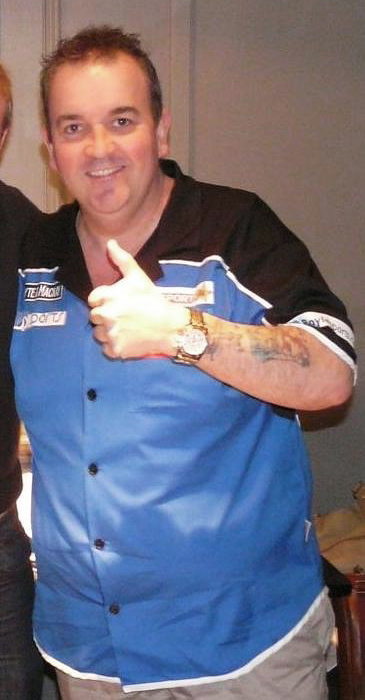 Phil Taylor (pictured in 2009) won his tenth world darts championship and eighth in a row with a 7-0 whitewash of Manley. Philtaylor.jpg