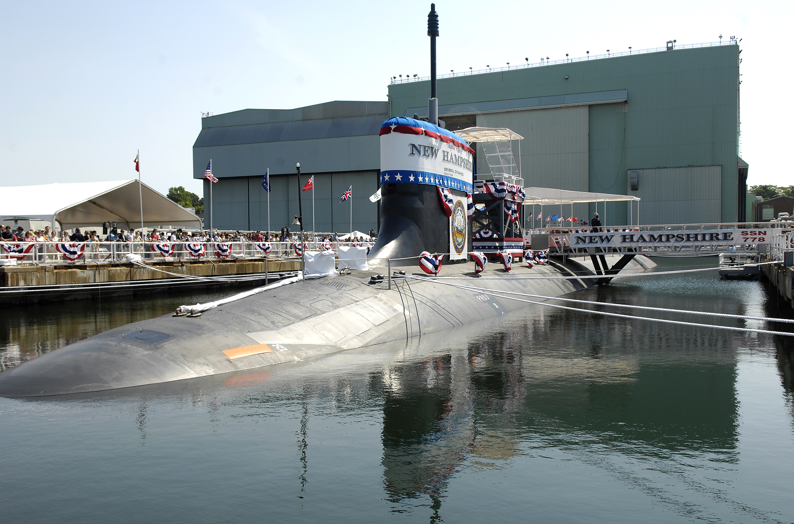 US Navy 080621-N-8467N-001 Pre-commissioning Unit New Hampshire (SSN 778) sits moored to the pier at General Dynamics Electric Boat shipyard moments before her christening ceremony commenced.jpg