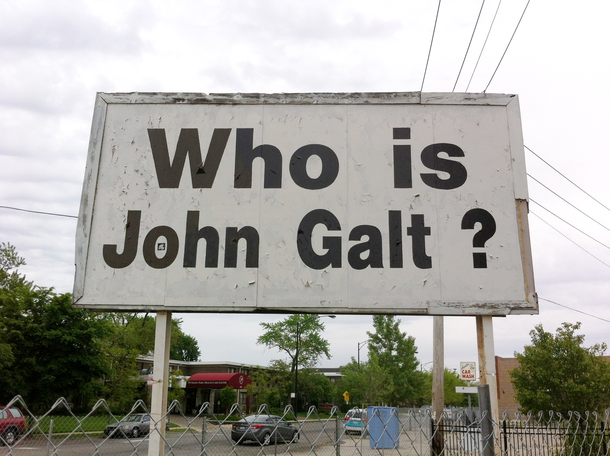 "A sign in Chicago with the question ""Who Is John Galt"""