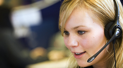 File:A woman working on a call centre.jpg