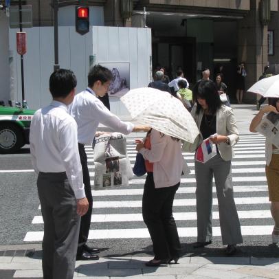 Distributing newspaper