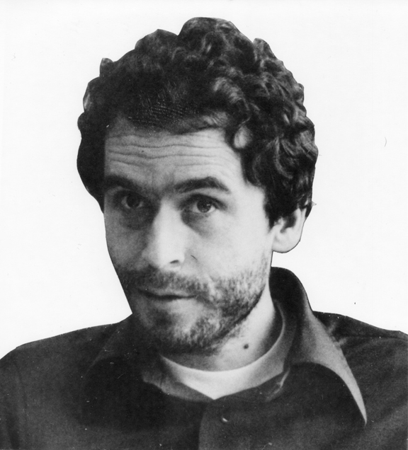 Black-and-white photo of a man with curly hair