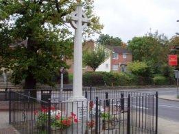 Fair Oak War Memorial showing the present 'fair oak' behind .