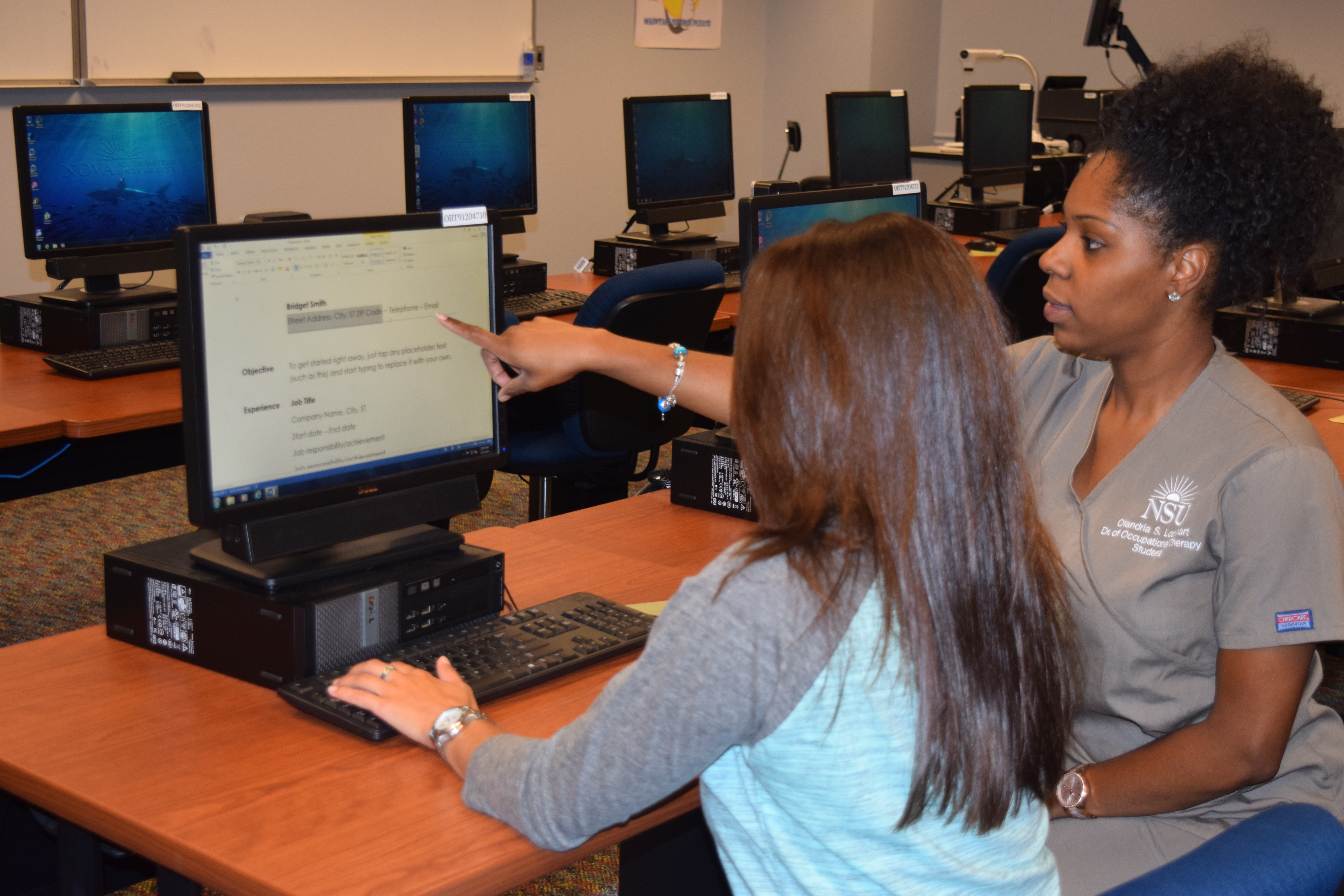 fileoccupational therapist helping a client create a job resume to send out to future