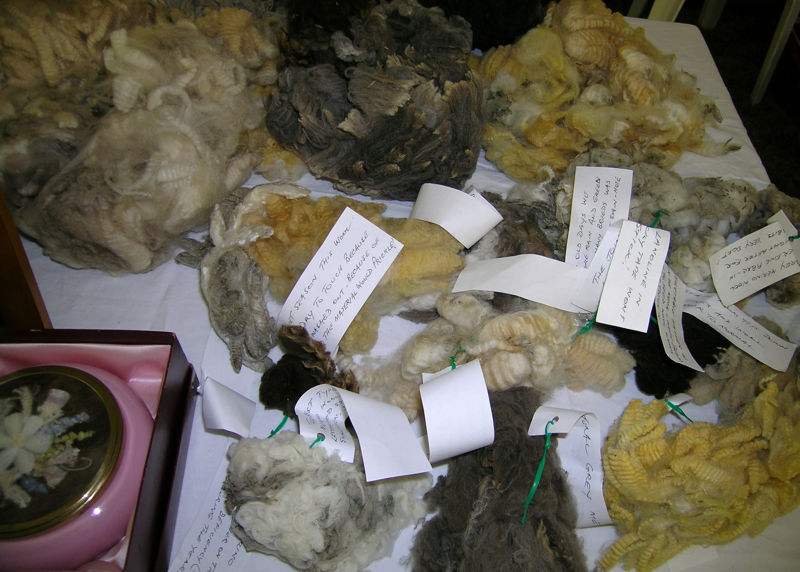 Various types and natural colors of wool, and a picture made from wool