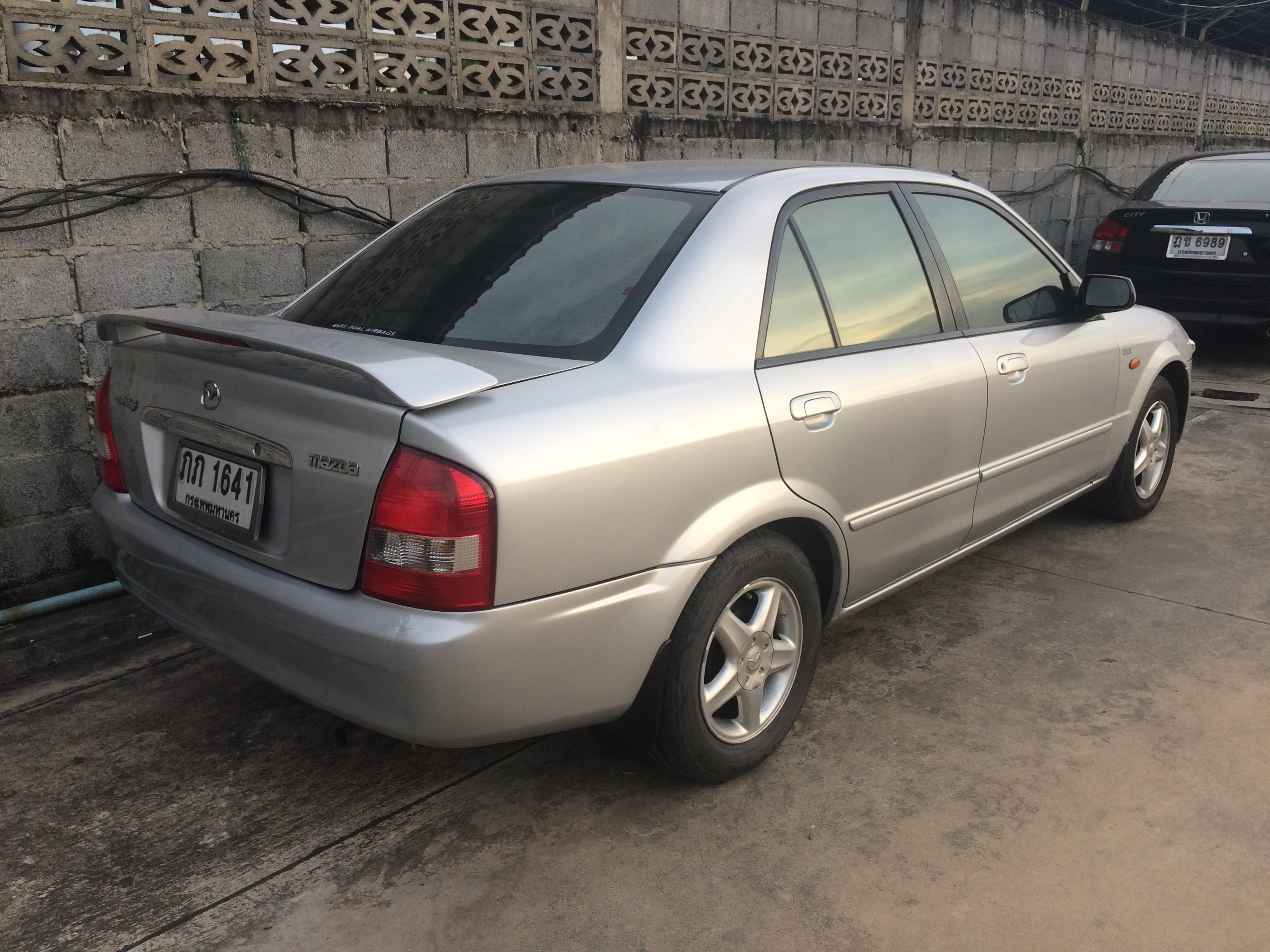 Kekurangan Mazda 323 2000 Harga