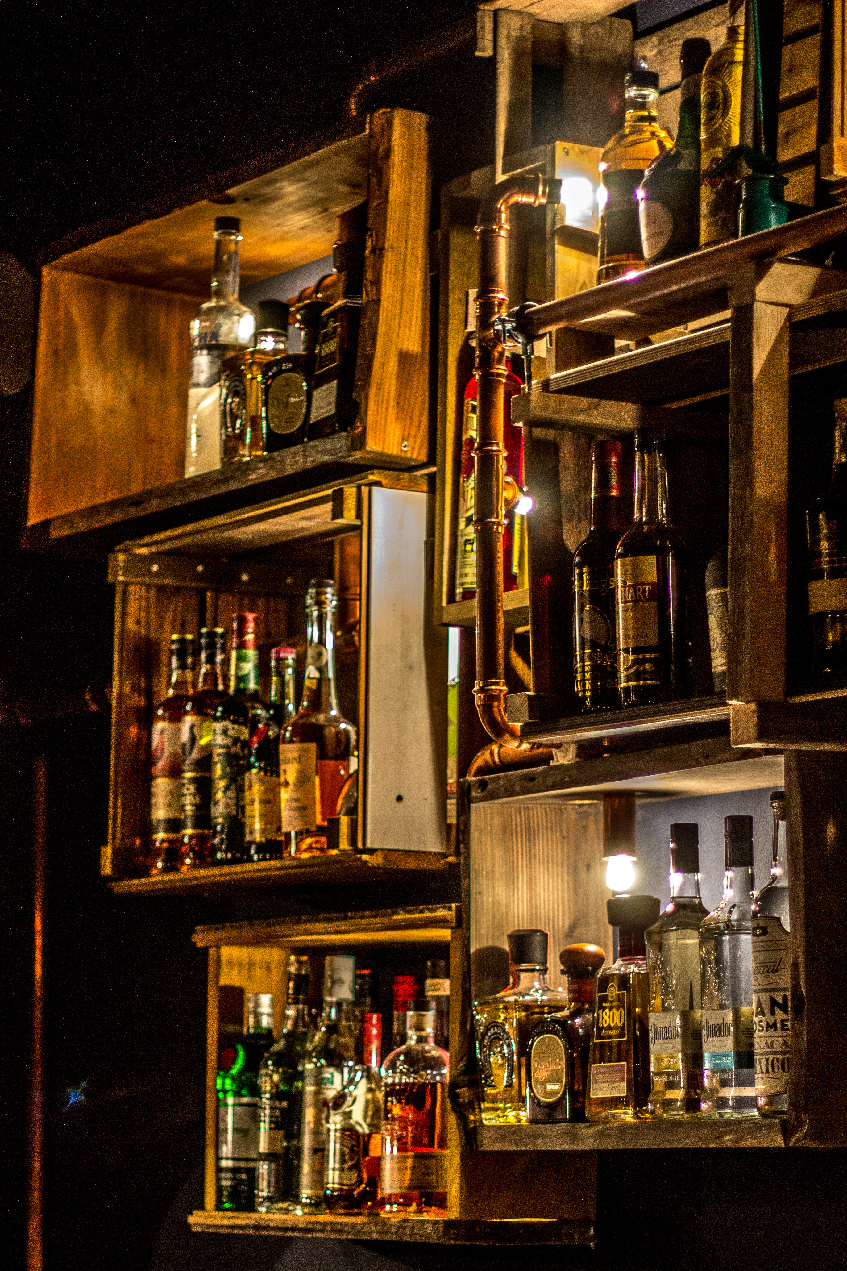 File:Backbar with various bottles of spirits.jpg - Wikimedia Commons