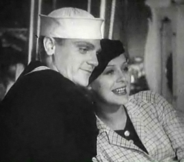 Cagney in a sailor suit with a smiling actress leaning on him.