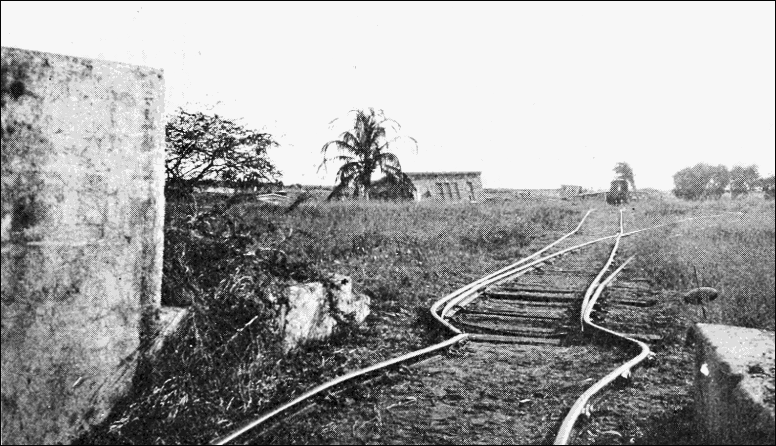 PSM V70 D403 Twisted rails and tilted buildings at the victoria battery in port royal.png