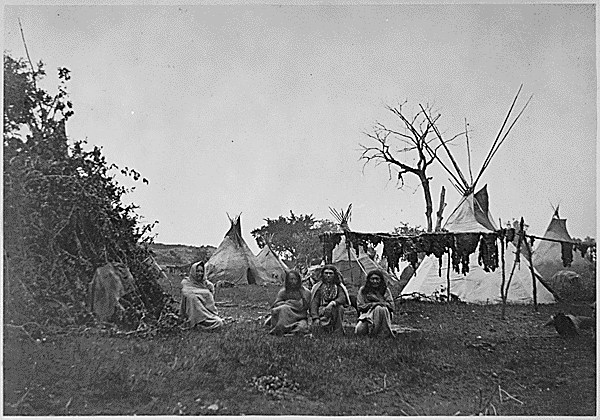 File:Arapaho camp with buffalo meat drying near Fort Dodge ...