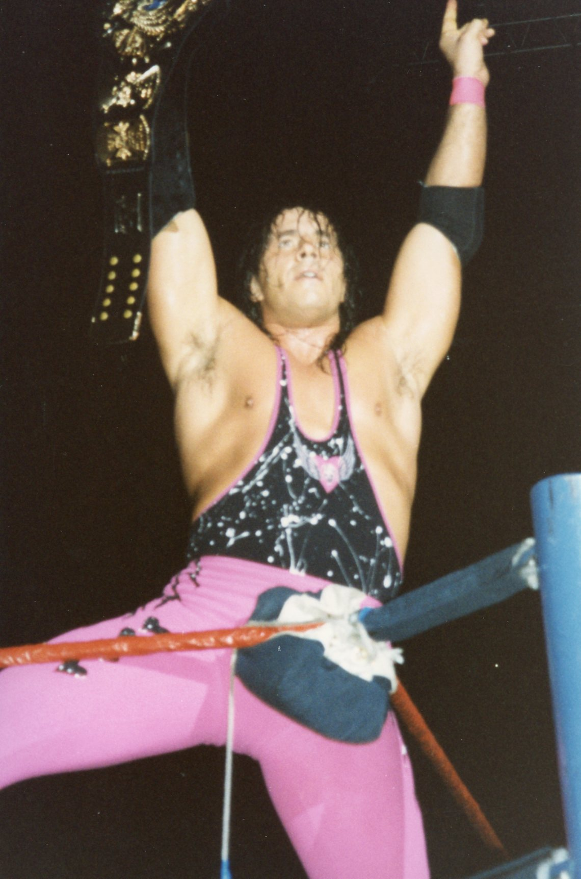 Bret Hart poses before defending his WWF Championship against Owen Hart at the Wembley Arena in London.. Taken 9/14/1994. Photo by Mandy Coombes, CC BY-SA 2.0 , via Wikimedia Commo