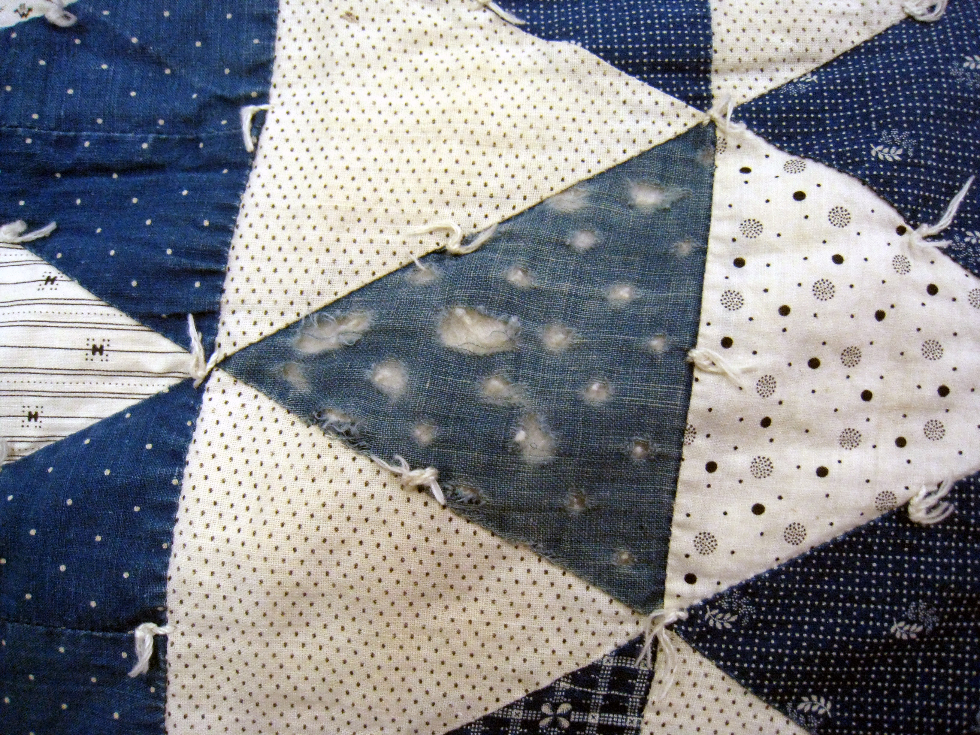 English: Detail of a vintage patchwork quilt s...