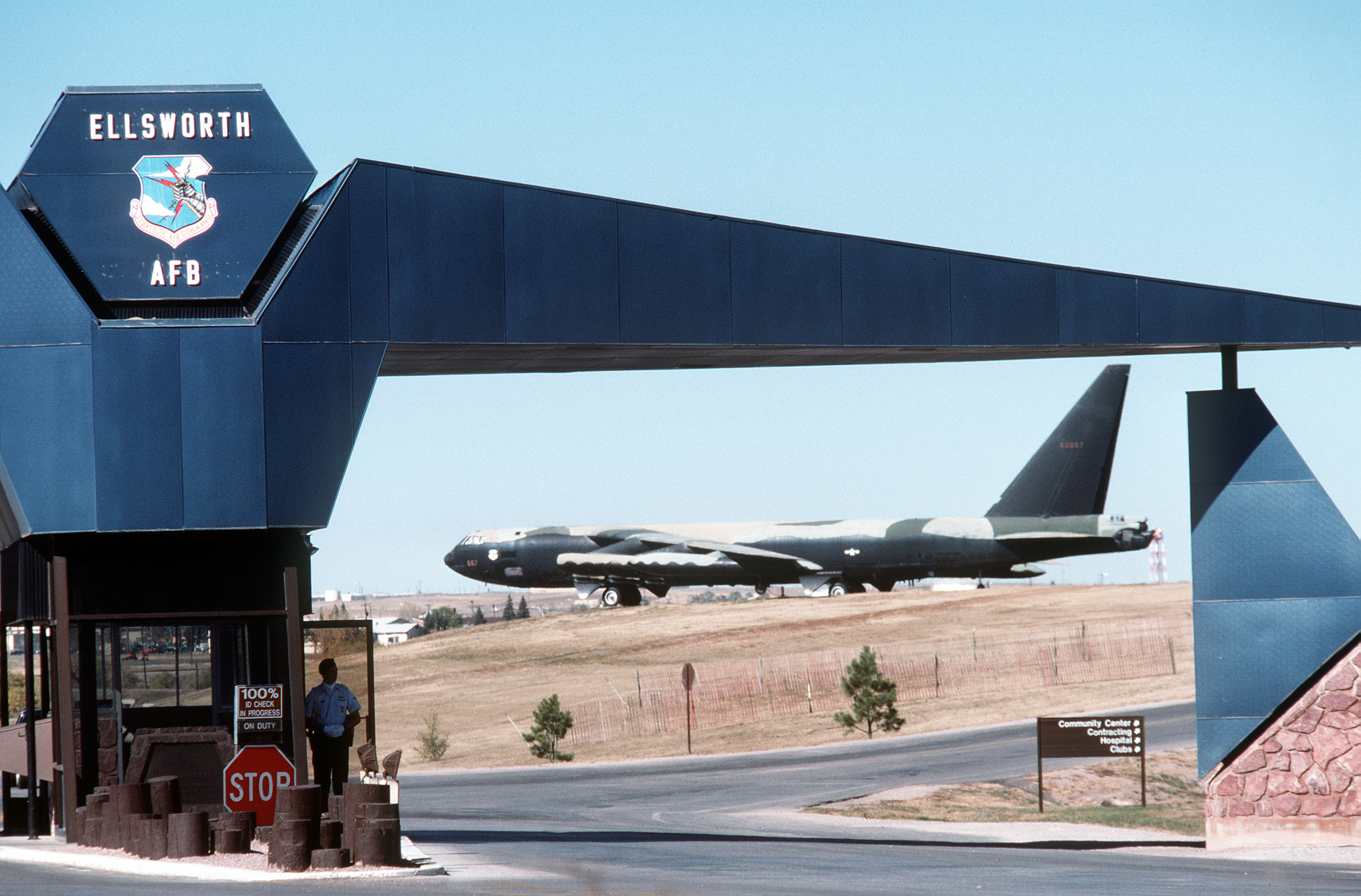 Ellsworth AFB Main Gate with a B-52D on static display in the background, c.1988.