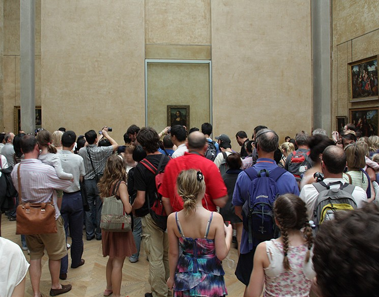 A crowd of people in a museum