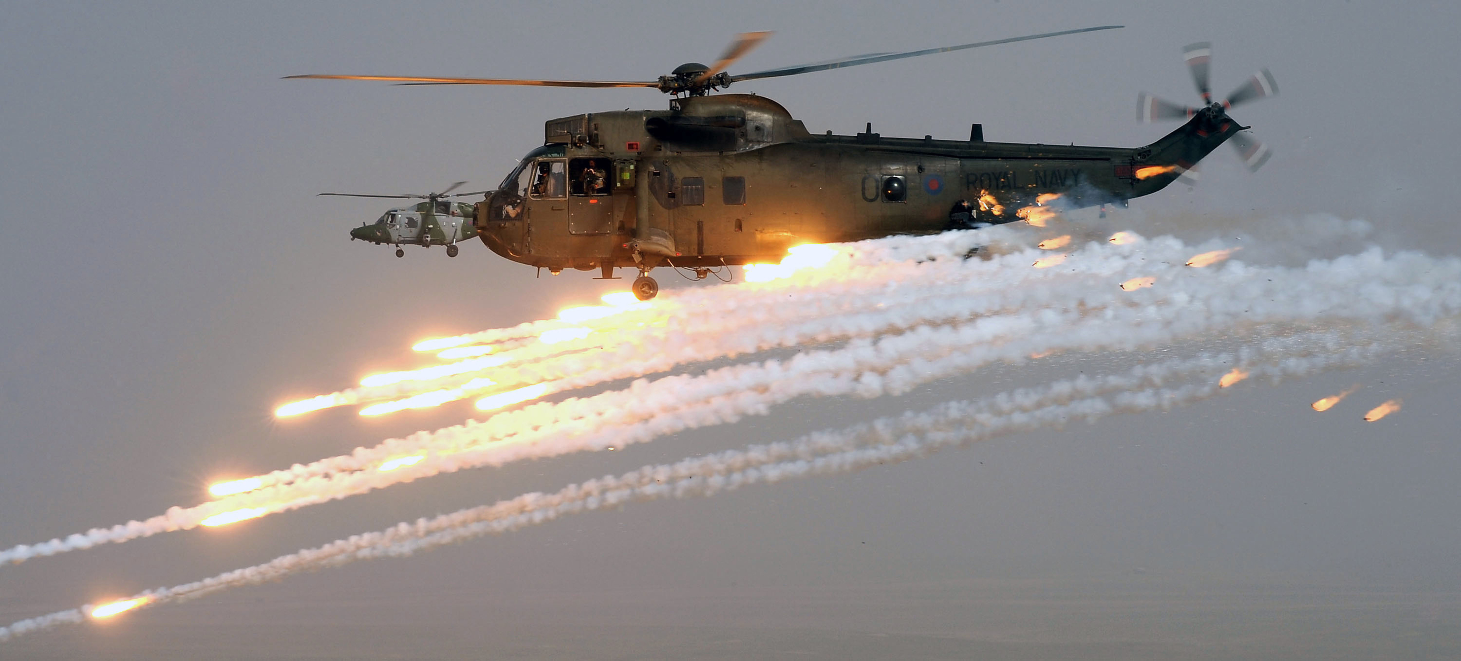 flying helicopters with File Royal Navy Sea King Mk 4 Helicopter Firing Decoy Flares In Afghanistan Mod 45154056 on NR 26093 additionally Piasecki HRP Rescuer further Why Was The Bell Boeing V 22 Osprey Not Worked On More as well Stock Photo Westland Sea King Xv663 Helicopter Cockpit And Controls 54660720 together with File Army Air Corps Apache Attack Helicopter MOD 45155704.