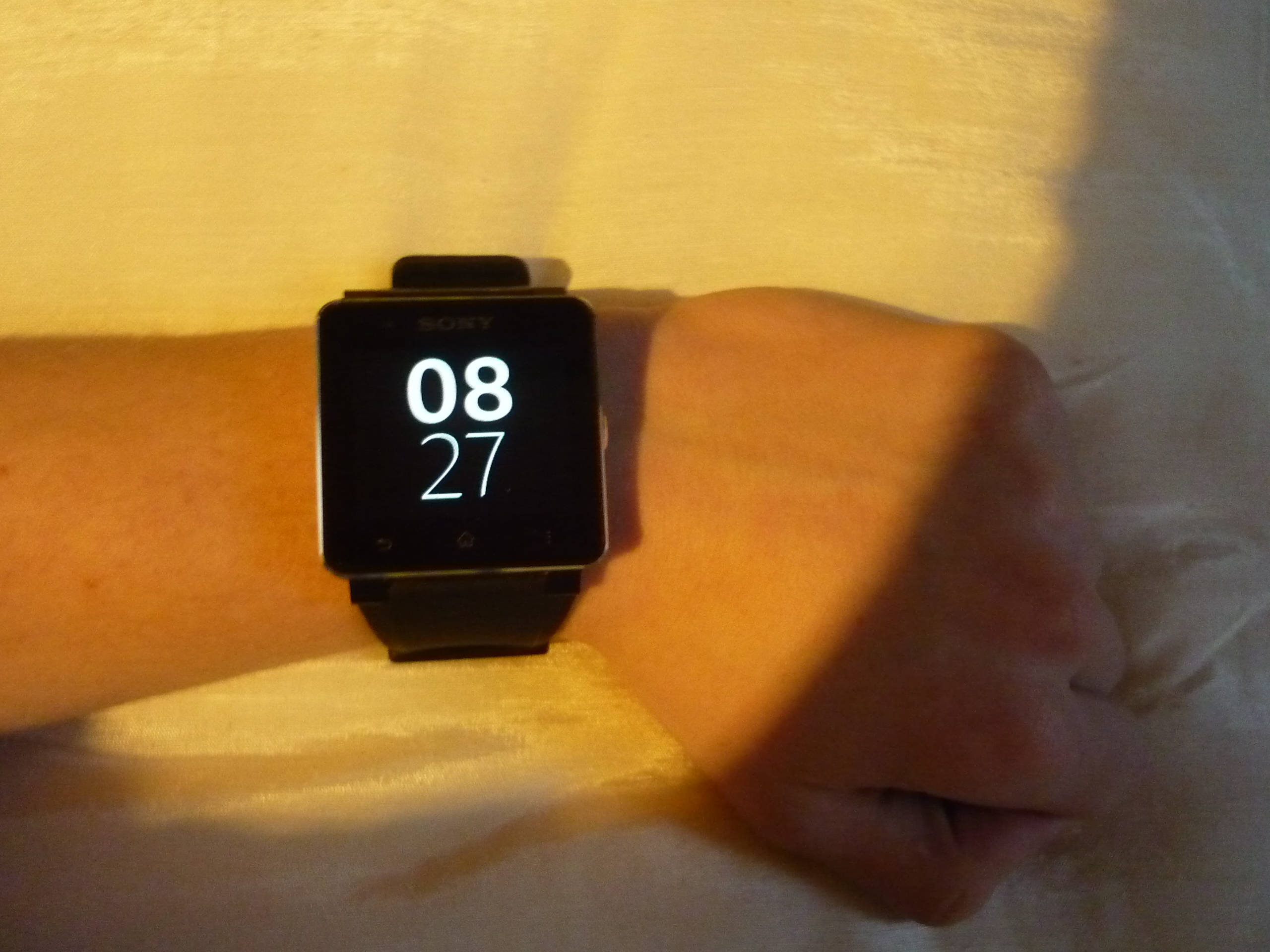 Sony smartwatch on a wrist.