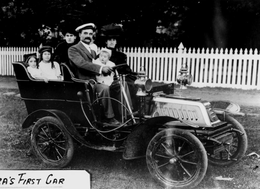 Sharpe family posing in their new car – See page for author [Public domain], via Wikimedia Commons