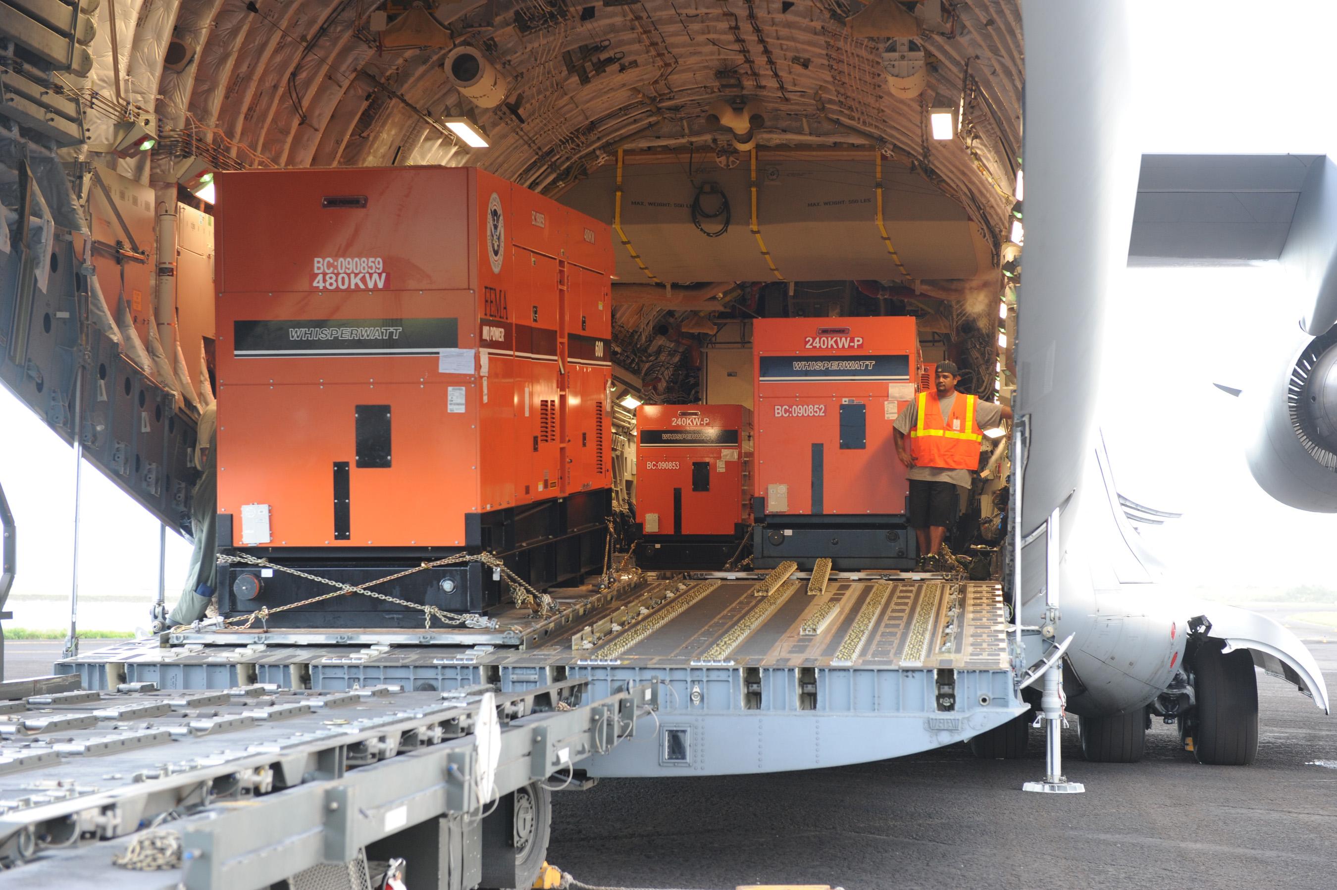 File FEMA Emergency Generators being unloaded from a C