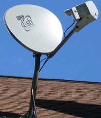A satellite television dish, an example of an ...