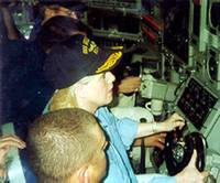 [Tipper Gore at the helm of USS Greeneville during a distinguished visitor embarkation mission in 1999]