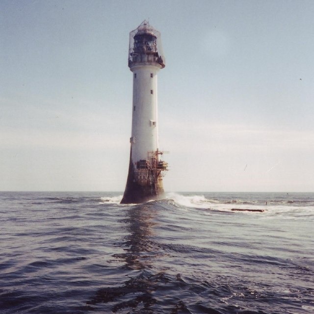 lighthouse rising out of the sea