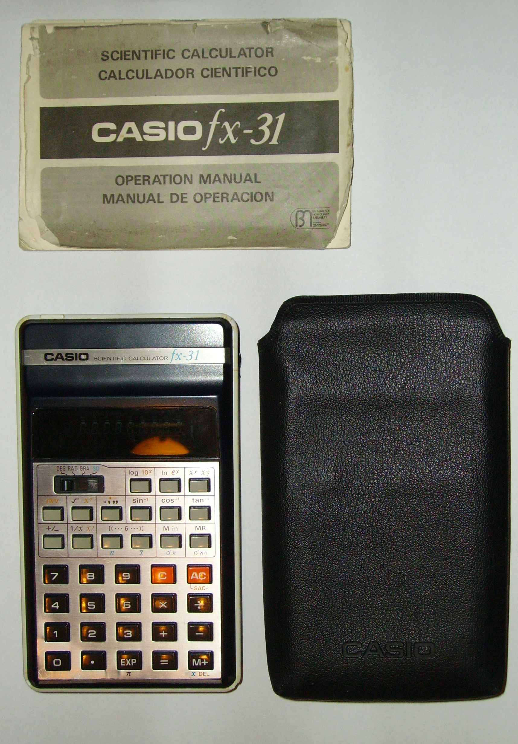 File:Casio fx-31 with case and manual.jpg
