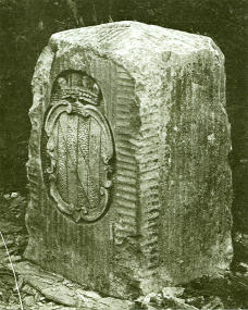 "A ""crownstone"" boundary monument on the Mason–Dixon line. These markers were originally placed at every 5th mile (8.0 km) along the line, ornamented with family coats of arms facing the state that they represented. The coat of arms of Maryland's founding Calvert family is shown. On the other side are the arms of William Penn."