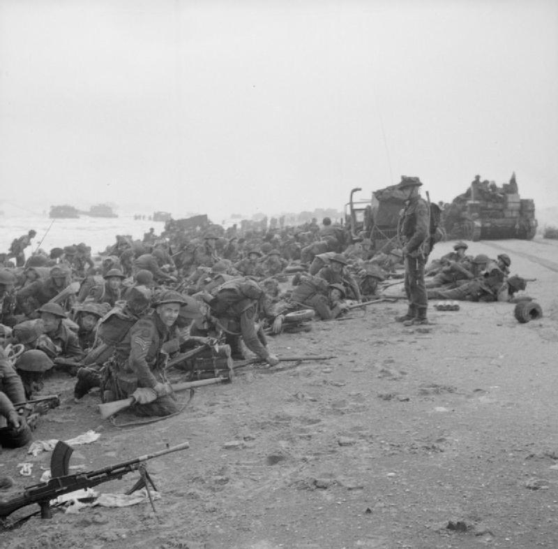 Troops_crouch_down_on_Sword_Beach.jpg