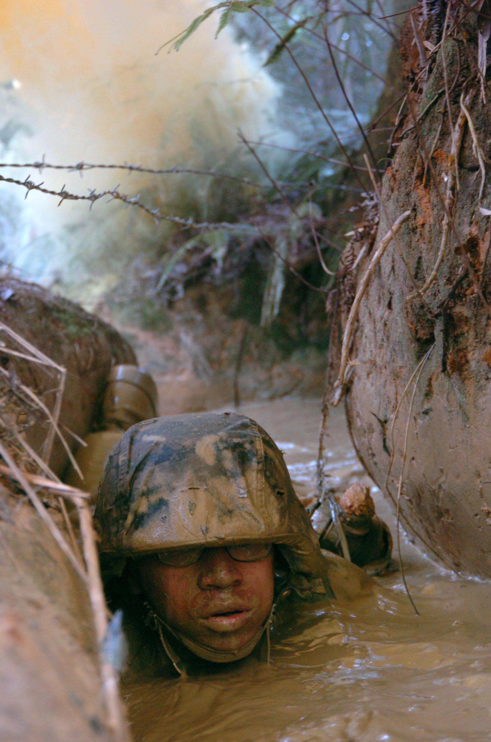 File:US Navy 050225-N-9712C-007 A U.S. Marine low-crawls