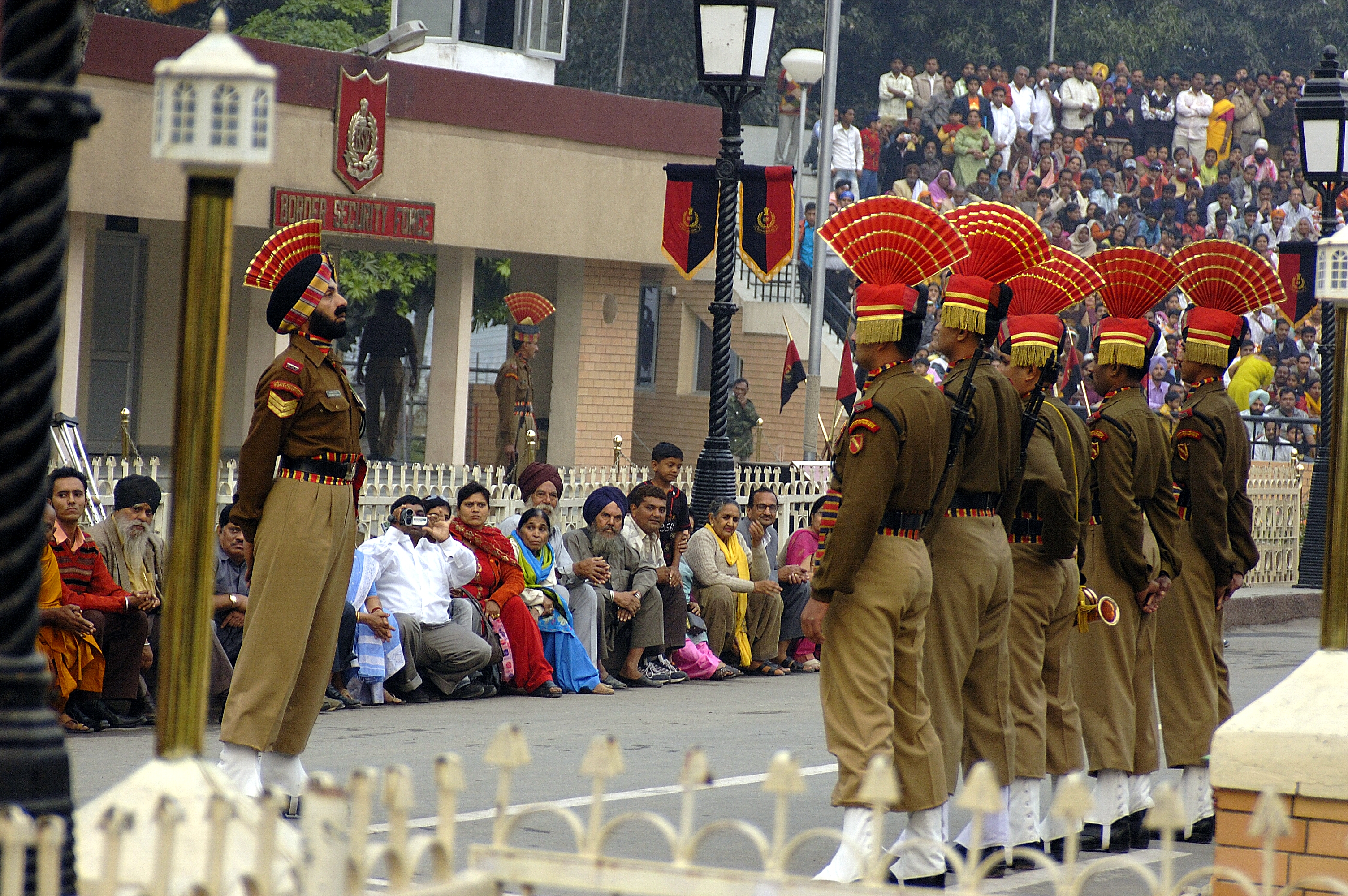 wagah border India and pakistan go ahead with a military ceremony at the wagah border crossing, despite earlier plans to suspend it after a big suicide attack.