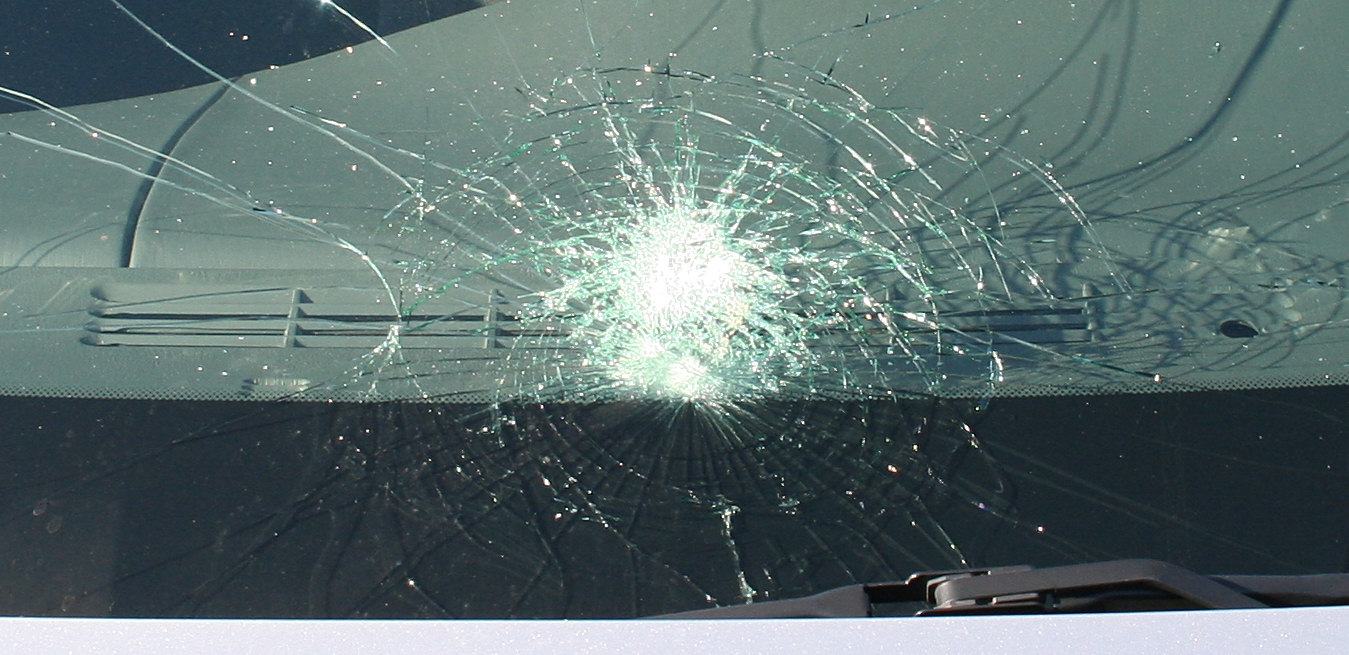 http://upload.wikimedia.org/wikipedia/commons/c/cb/Windshield-spiderweb.jpg