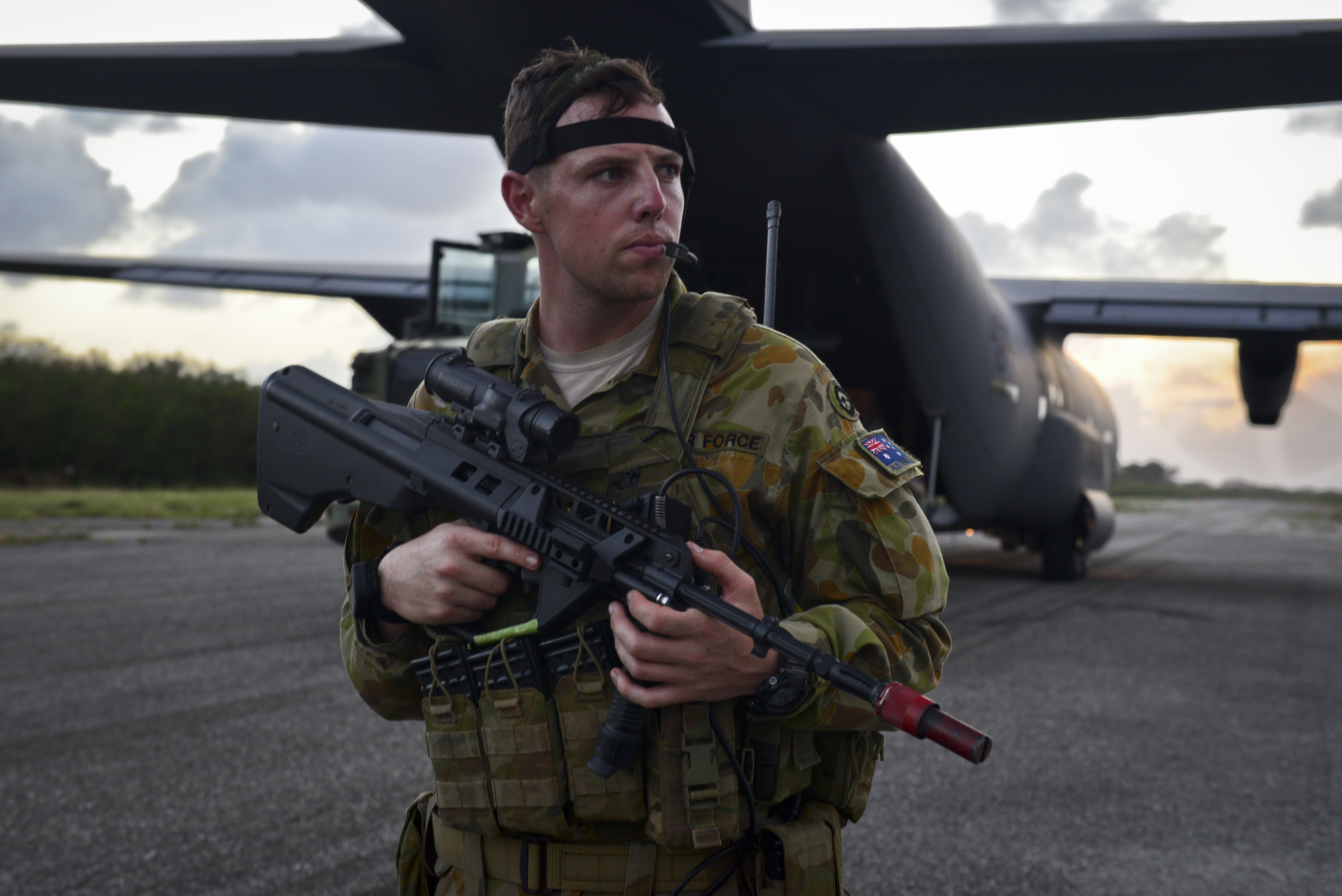 File:RAAF security forces member with a C-130J Hercules