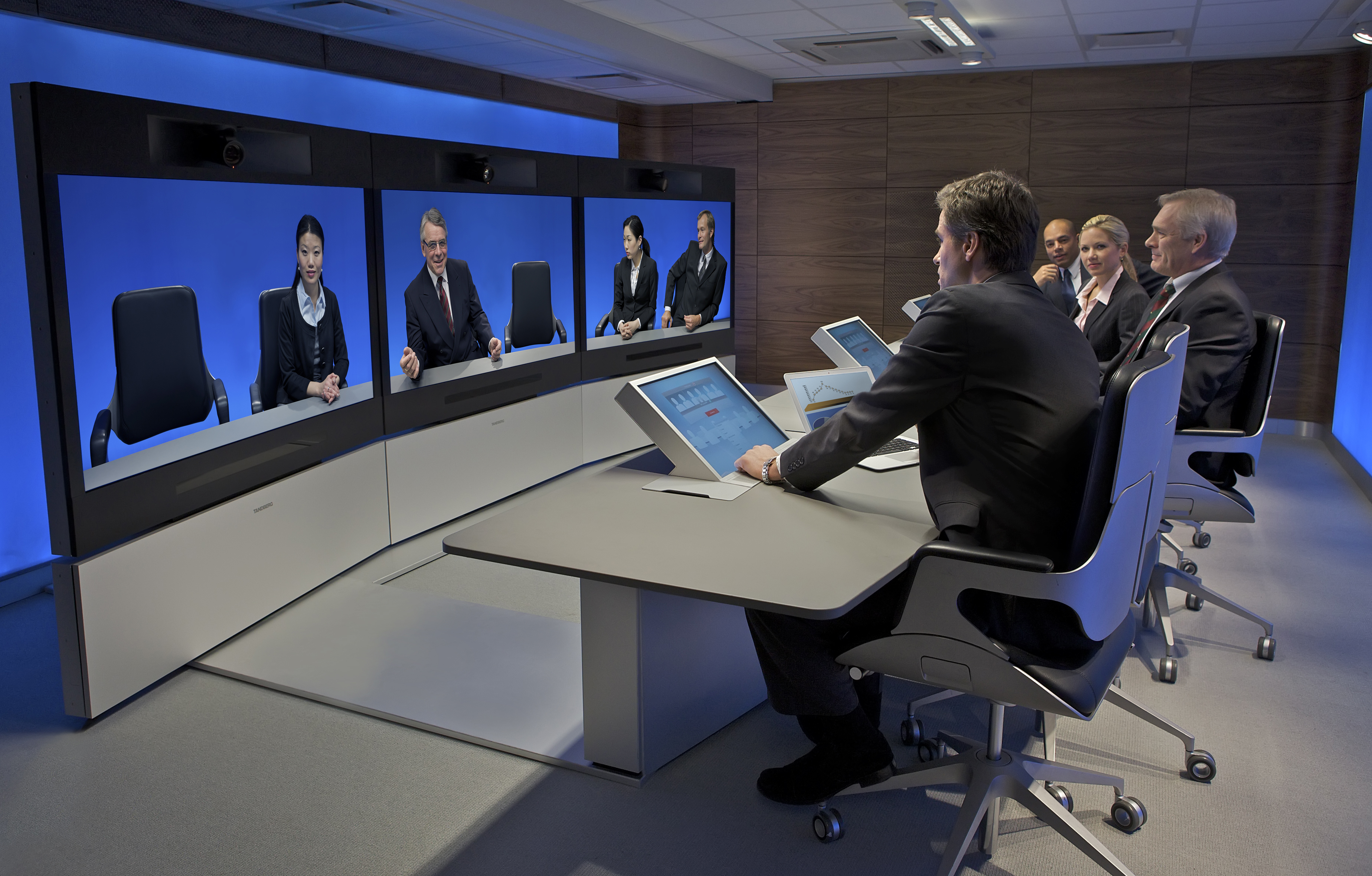 A Tandberg T3 high resolution telepresence room in use (2008).