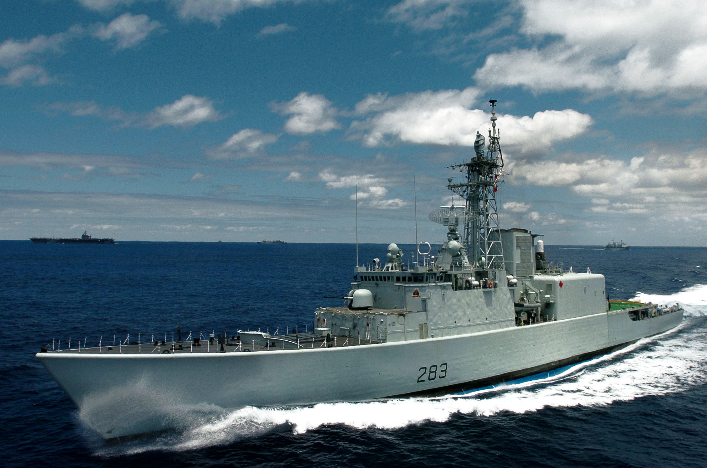 the canadian destroyer hmcs algonquin  ddg 283  underway in close formation with the nimitz
